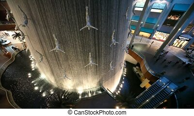 waterfall inside Dubai Mall in Dubai, UAE - DUBAI - APRIL...
