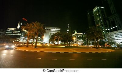 Dubai International Financial Centre at night time in Dubai,...