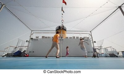 family playing basketball on cruise ship - bottom view on...