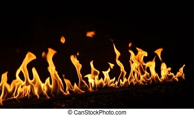 close shot on wall of fire on dark background