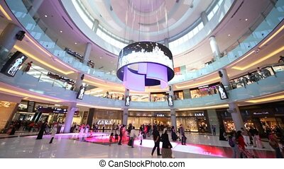 Shoppers at Dubai Mall in Dubai, United Arab Emirates -...
