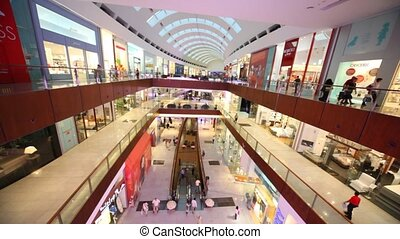 Dubai Mall from inside, with visitors in it in Dubai, UAE. -...