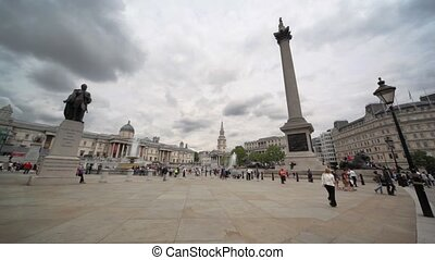 People are going on Trafalgar Square in London, UK. - LONDON...