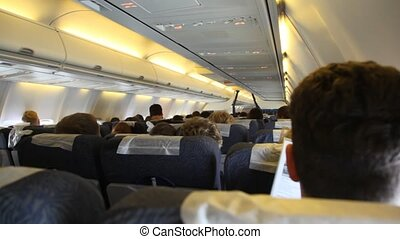 people sitting in airplanes board during flight