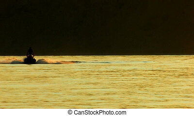 Jet Boat in the sea at sunset