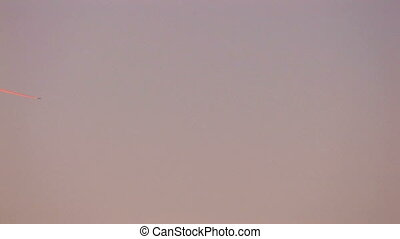 Jet leaving contrail at sunset, Canon XH A1, 1080p, 25fps,...