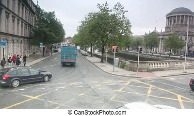 Cars and peoples moving on street of Dublin