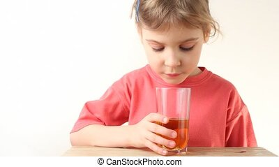 little girl drink orange juice on white background