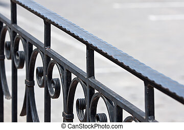 Old iron banister - Closeup of vintage wrought-iron banister
