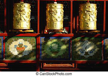 Golden prayer wheels in Tibet