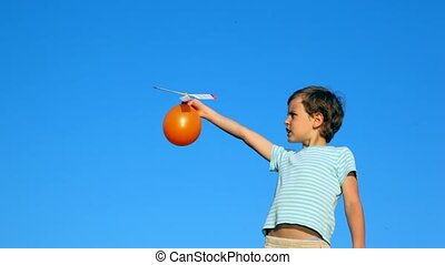boy launching ball with airscrew against sky - boy launching...
