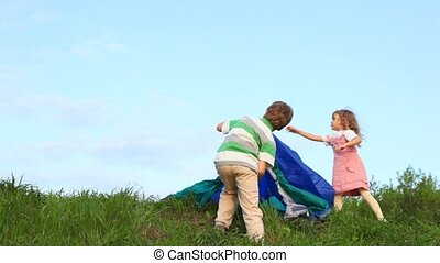 boy and little girl tenting outdoors