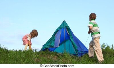 boy and his kid sister tenting outdoors - boy and his kid...