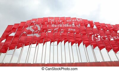 many big red communist flags waving by wind, bottom view