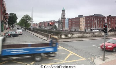 Cars and peoples moving on crossroad in Dublin, Ireland
