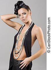 beutiful and sensual girl with necklace and hair style