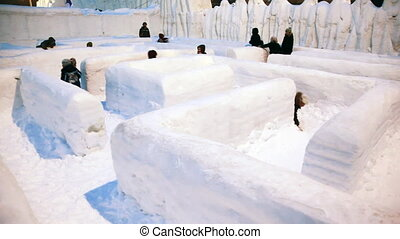 children go labyrinth made completely from snow, and unknown...