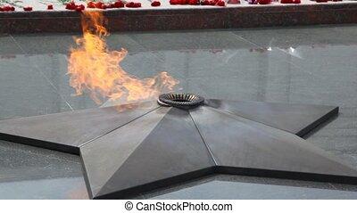 close-up shot of eternal fire on Poklonnaya Hill monument,...
