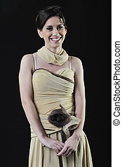 young woman in beautiful luxury dress in studio against...