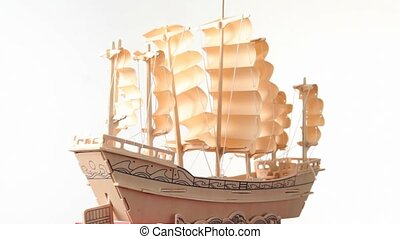 wooden model of ship rotating on white background