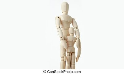 wooden figures of parent embracing his child from back -...