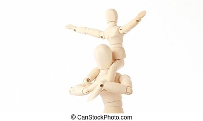 rotating wooden figures of child sits on neck of man, half...