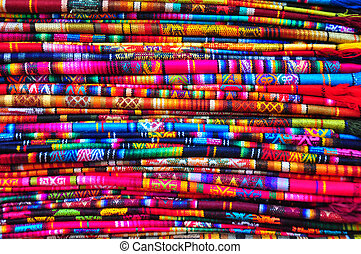 Traditional woven fabric - Brightly coloured textiles in...