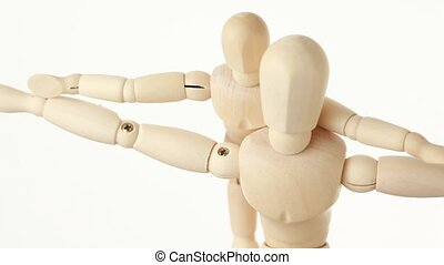 rotating wooden figures parent and child, hands apart, half...