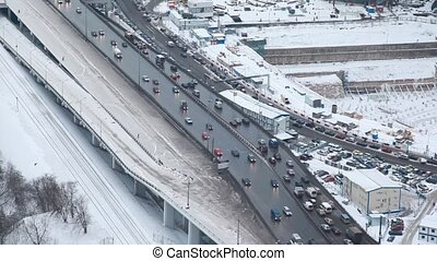 cars traffic near foundation pit on street of Moscow city, top view