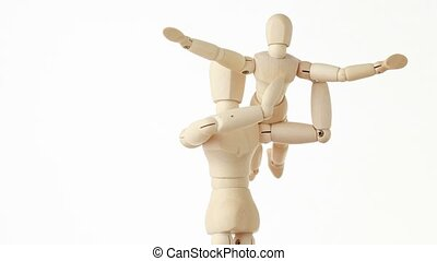 rotating wooden figures parent holding his child on hands,...