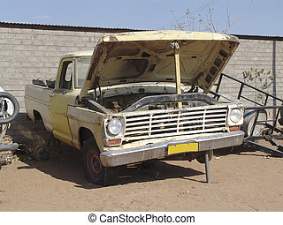 Old truck on a farm land. Desert background. Some service...