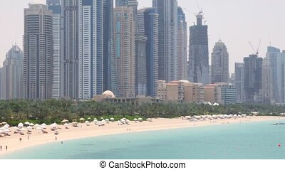 General view on beach and skyscrapers of Dubai city - DUBAI...