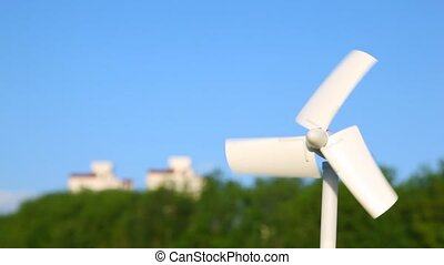 white tiny wind driven generator rotating, nature and...