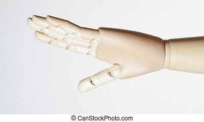 rotating wooden open palm of mannikin on white background