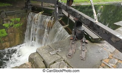 man-made waterfall and sluice, 4th Lock, Circle Line, Grand Canal, Baggott Street in Dublin, Ireland