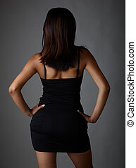 Little Black Dress - Young voluptuous Indian adult woman...