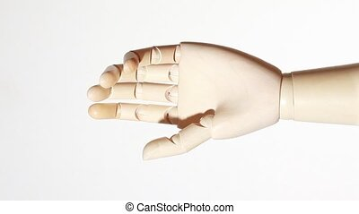 relaxed, little bended hand of wooden mannikin rotating on...