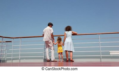 bottom view on family walks on deck of ship