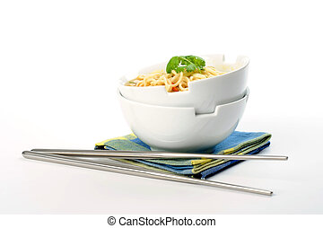 Noodles - Bowls of oriental style noodles on a white...