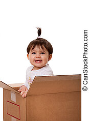 Happy baby in moving box - Happy baby girl in brown moving...