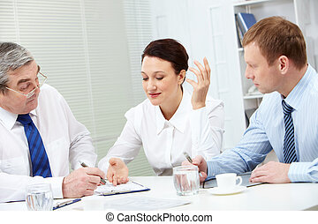 Debating - Image of confident colleagues looking for new...