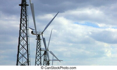 group of spinning wind turbines, closeup, Canon XH A1, 720p...