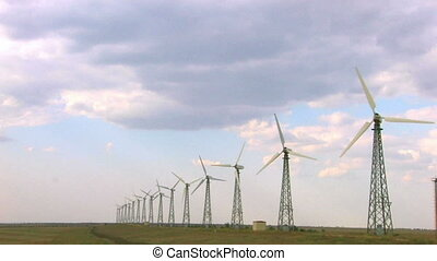 group of spinning wind turbines