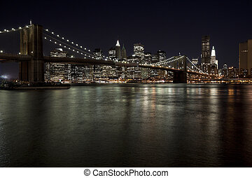 The New York City skyline w Brooklyn Bridge - The New York...
