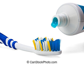 toothbrush and toothpaste isolated on a white background