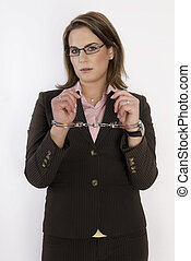 Business woman with handcuffs on her hands.