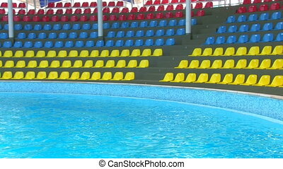 Panorama of empty auditorium and swimming pool, Canon XH A1,...