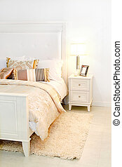 Bedroom detail - Detail of elegant cozy white bedroom with...