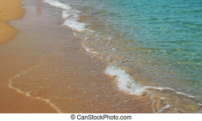 turquoise sea water waves and sand beach