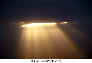 Light from heaven - Sun shining through the dark clouds...